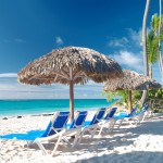 Beautiful caribbean beach with chaise lounge in Dominican Republ