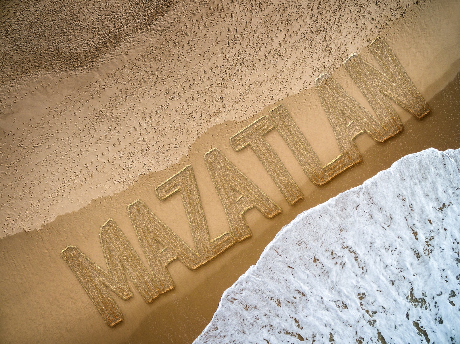 Mazatlan written on the beach